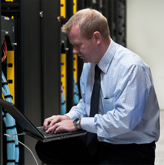 guy at computer in server room
